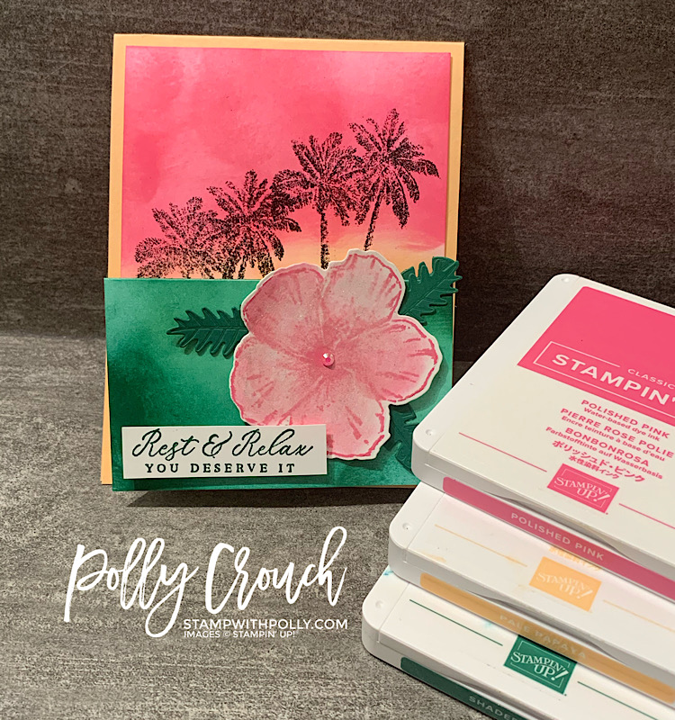 This is a photo of the completed card next to the ink pads in Polished Pink, Pale Papaya & Evening Evergreen.