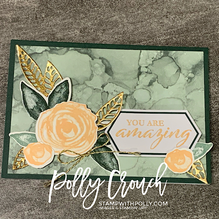 This is a notecard made with the June Paper Pumpkin kit. It is an Evening Evergreen base with a soft succulent overlay and Pale Papaya flowers and gold foil leaves. The sentiment says You are amazing.